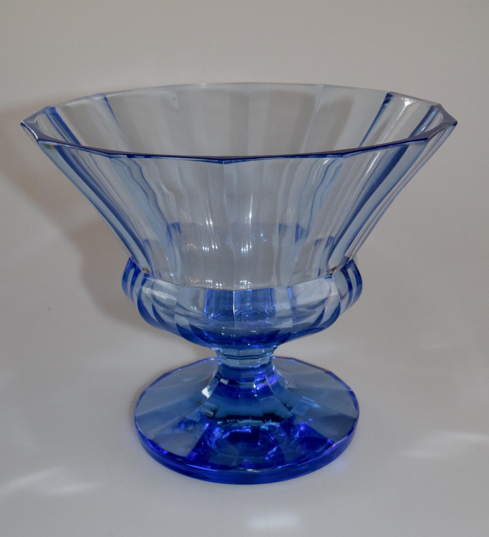 Blue cut bowl on foot.