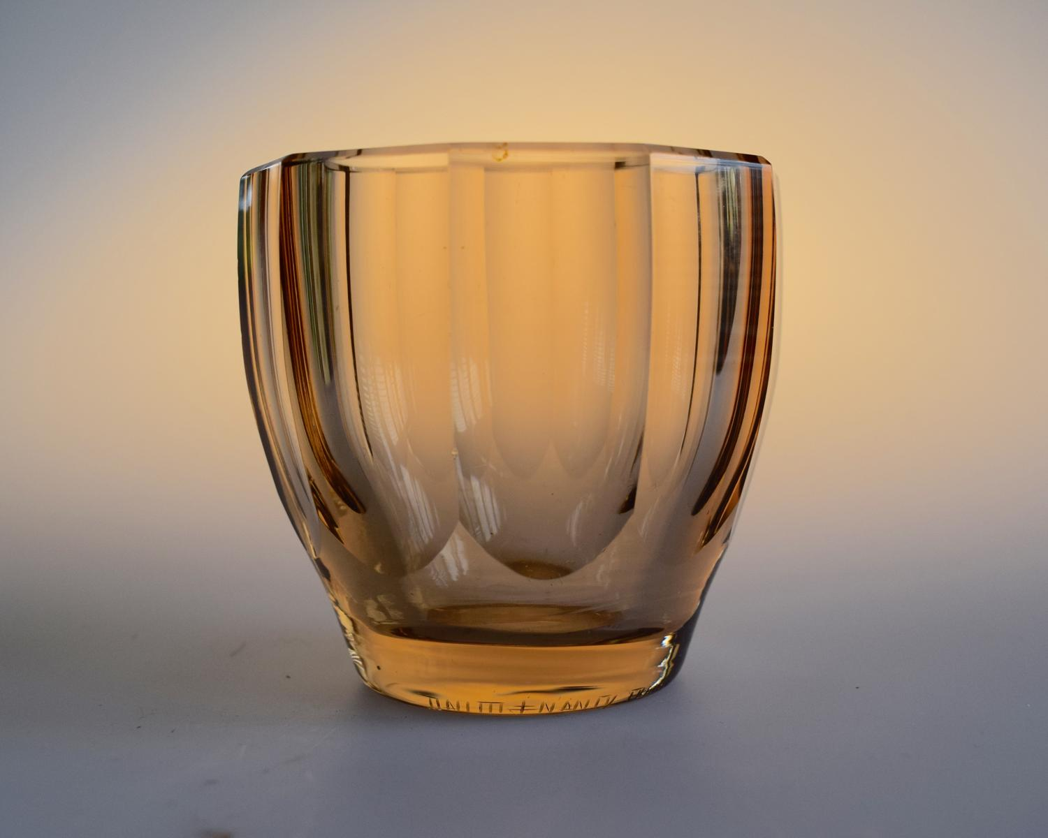 Small brown facetted bowl by Daum.