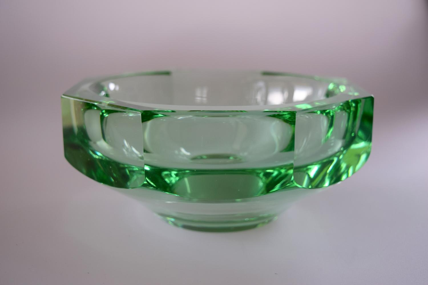 Thick green bowl by Daum .