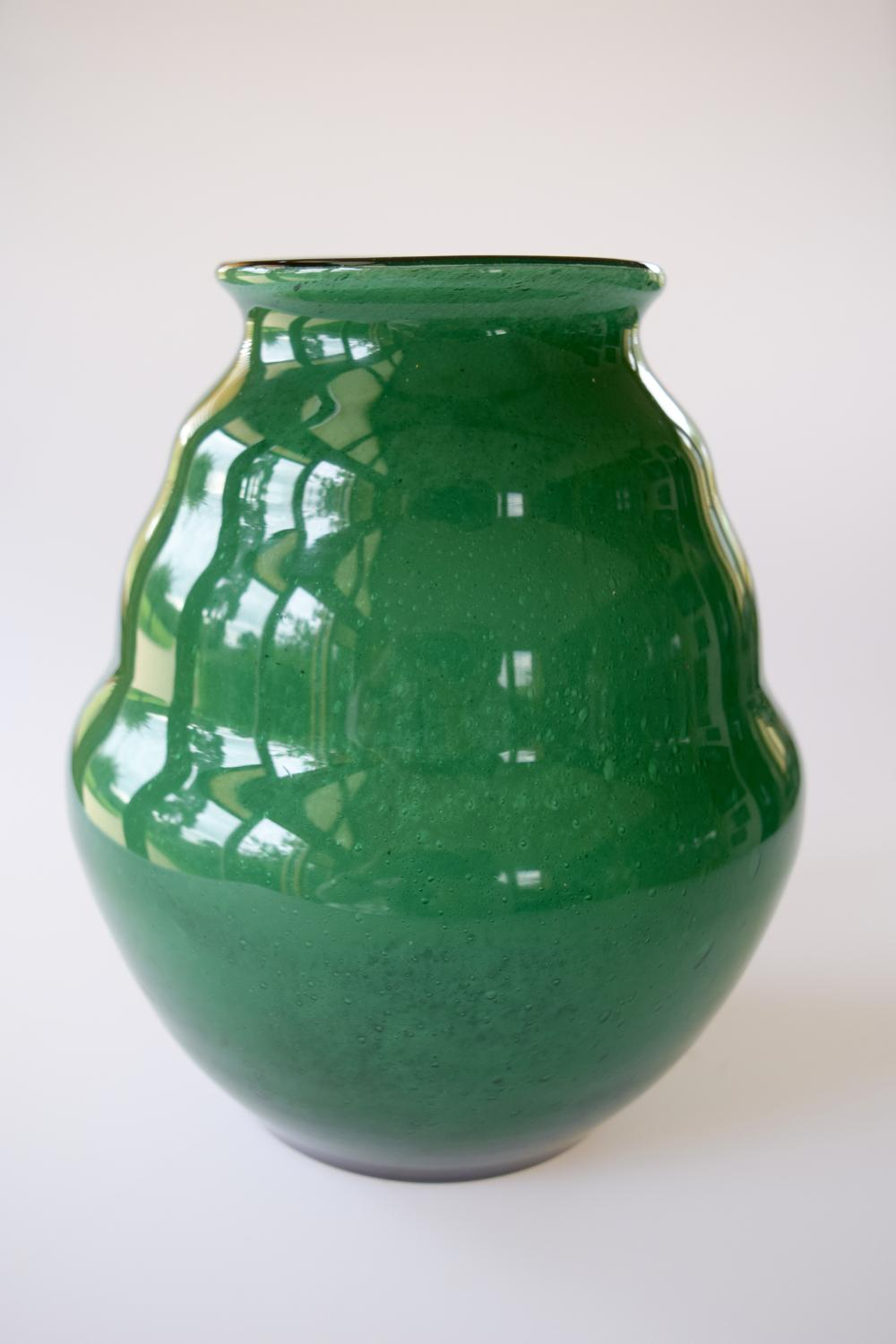 Bee hive shaped green cloudy vase.