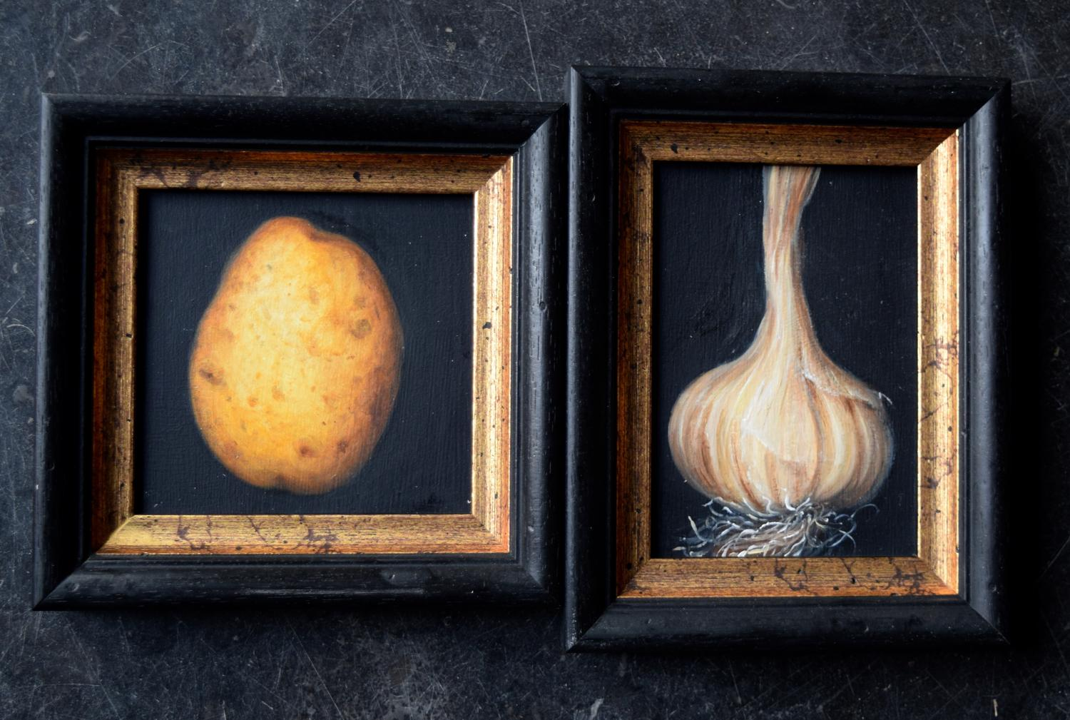 Paintings of a new potato and garlic