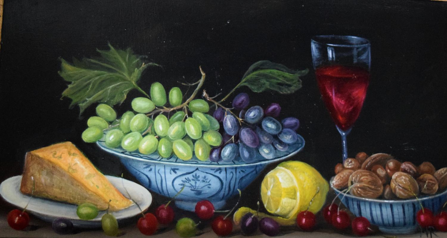 Still life of grapes, nuts and cheese.