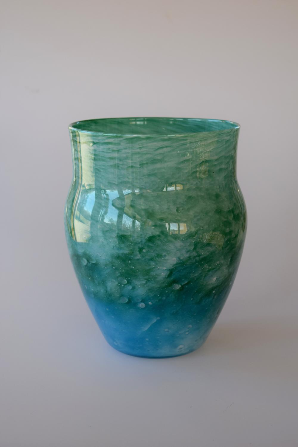 Cloudy blue and green urn shaped vase.