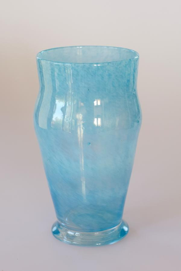 Small pale blue cloudy vase.