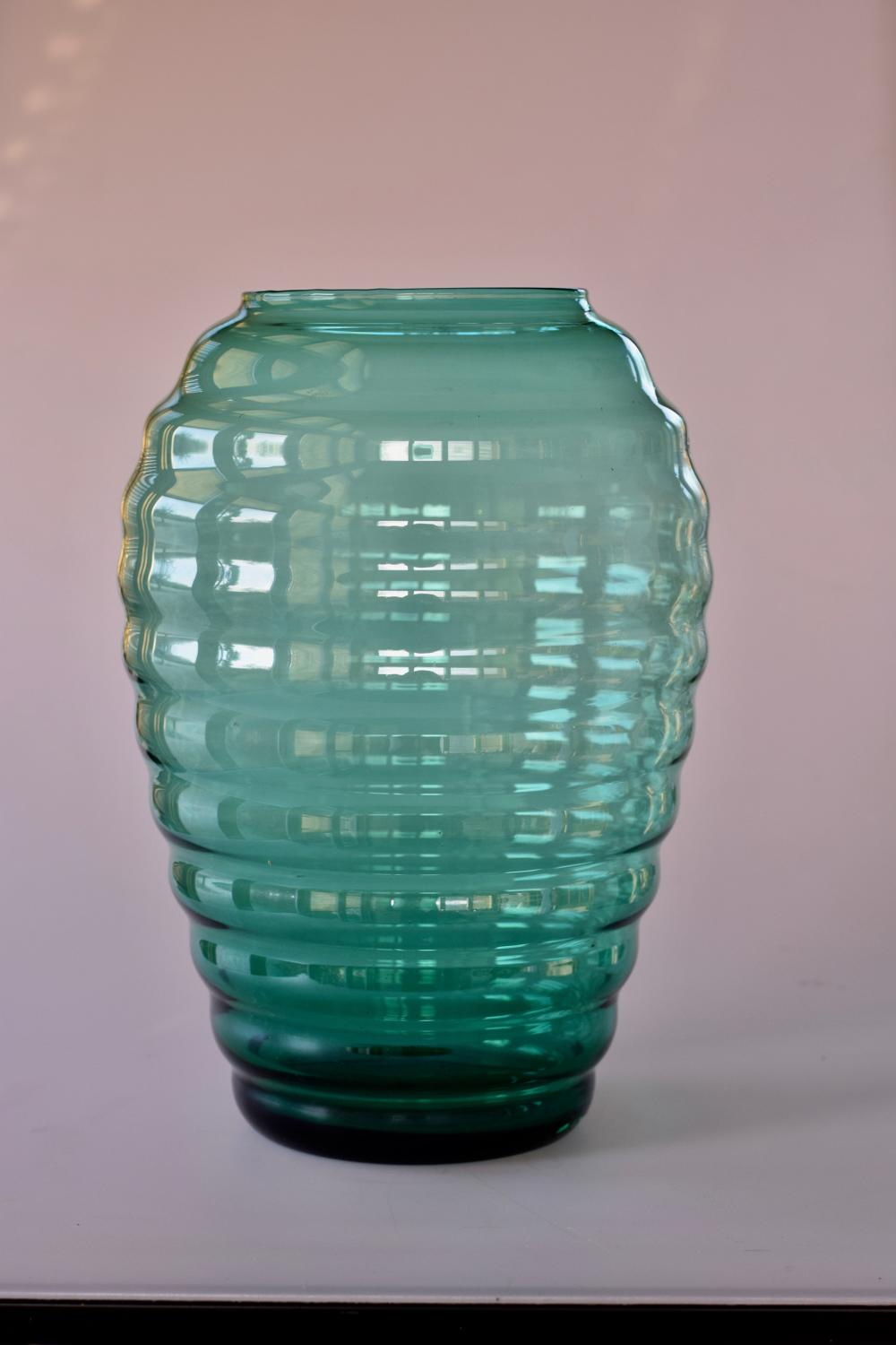 Tall green ribbed vase, Murano