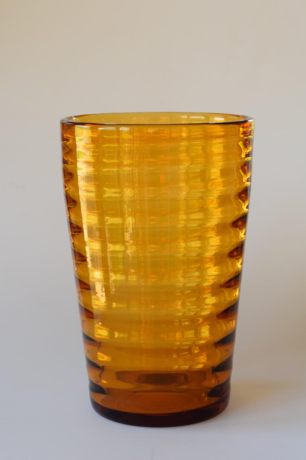 Scandinavian tall amber ribbed bucket vase.