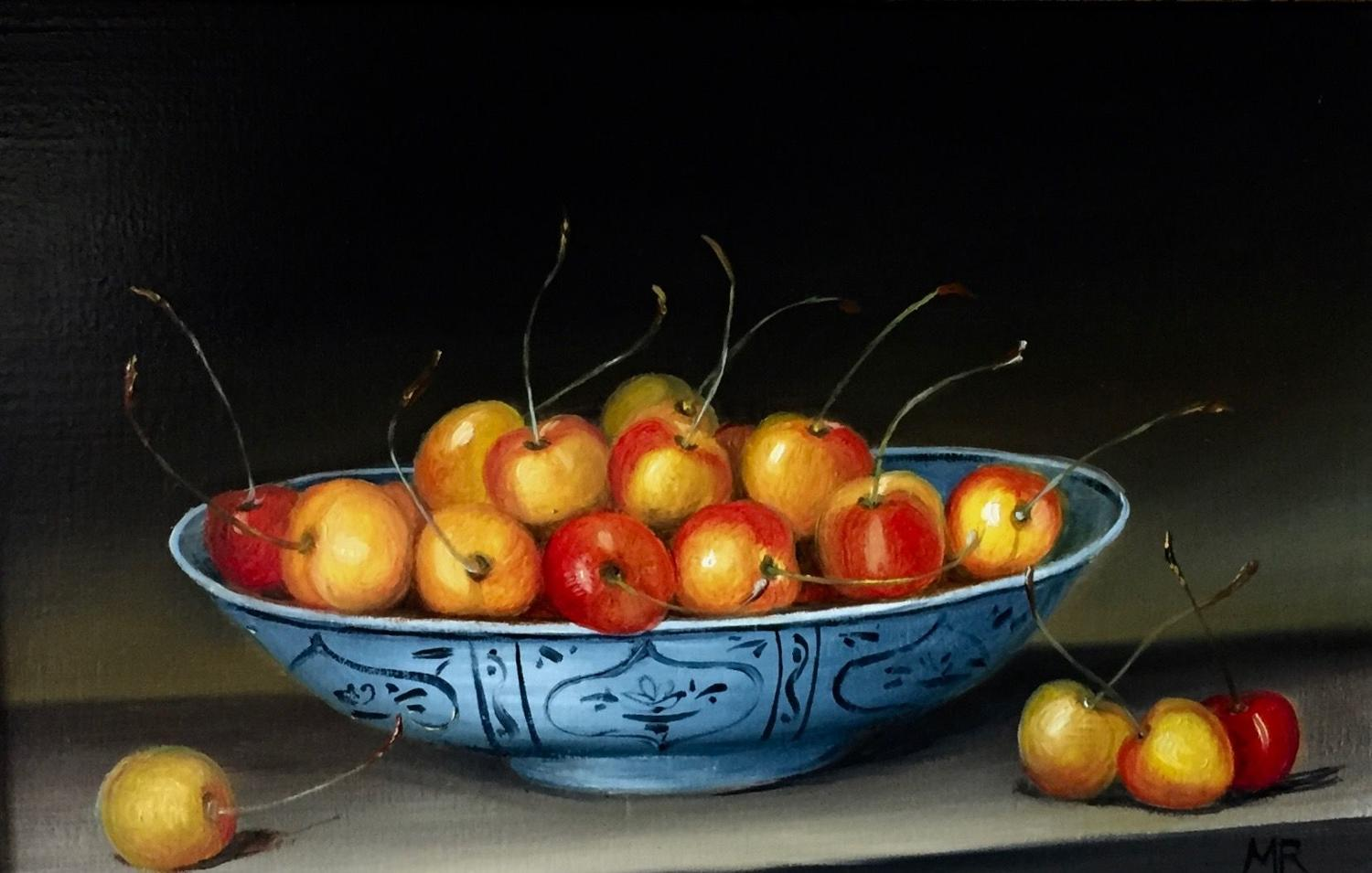 Bowl of yellow and red cherries