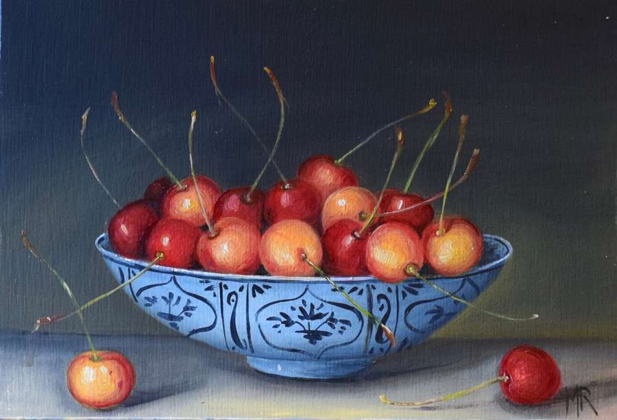 Red and yellow cherries in a bowl