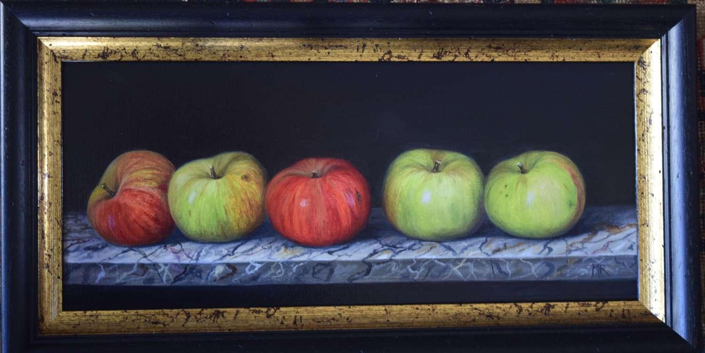 Shelf of apples